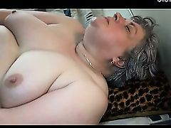 Fat granny masturbating with long black dildo