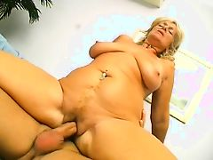 Old blond fat ass drilled by young prick on a couch
